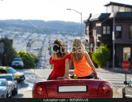 women in convertible car over san francisco stock photo, summer holidays, road trip, travel and people concept - happy women driving in convertible car over san francisco city background by Syda Productions