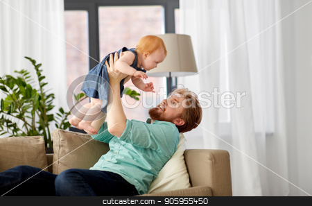 happy father with little baby girl at home stock photo, family, fatherhood and people concept - happy red haired father with little baby girl at home by Syda Productions