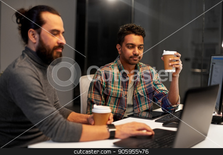 creative team drinking coffee at night office stock photo, deadline, technology and people concept - creative team drinking coffee and working with computers late at night office by Syda Productions