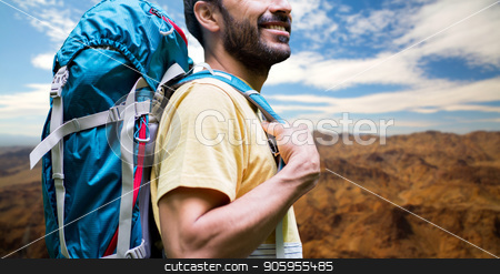close up of man with backpack over grand canyon stock photo, adventure, travel, tourism, hike and people concept - close up of smiling man with backpack over grand canyon national park hills background by Syda Productions