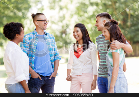 group of happy international friends in park stock photo, people, friendship and communication concept - group of happy friends talking in park by Syda Productions