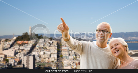 happy senior couple over san francisco city stock photo, old age, tourism, travel and people concept - happy senior couple over san francisco city background by Syda Productions