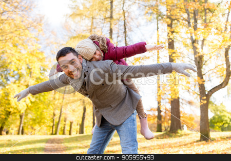 happy father and daughter playing at autumn park stock photo, family, season and people concept - happy father and little daughter playing at autumn park by Syda Productions