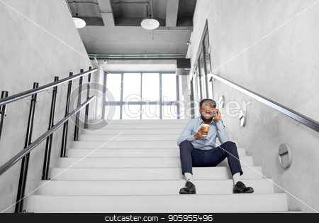 businessman with smartphone and coffee at office stock photo, business, people and technology concept - african american businessman with smartphone having break and drinking coffee at office by Syda Productions