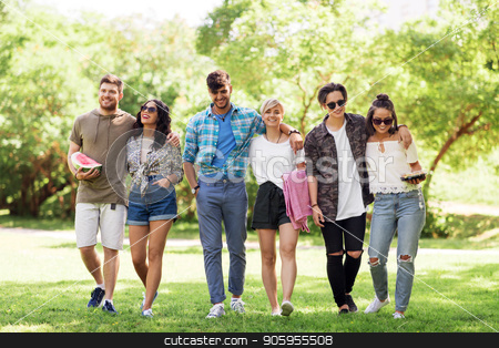 happy friends with picnic blanket at summer park stock photo, friendship and leisure concept - group of happy friends with picnic blanket and watermelon walking at summer park by Syda Productions