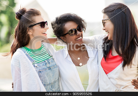 happy young women in sunglasses outdoors stock photo, female friendship, summer and eyewear - happy young women in sunglasses outdoors by Syda Productions
