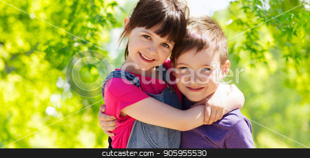 happy kids hugging over green natural background stock photo, childhood, friendship and family concept - two happy kids hugging over green natural background by Syda Productions