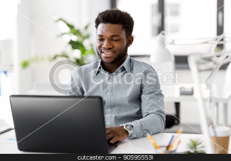 african american businessman with laptop at office stock photo, business, people and technology concept - african american businessman with laptop computer working at office by Syda Productions