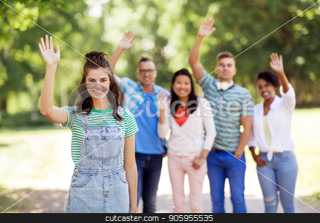group of happy international friends waving hands stock photo, people, friendship and international concept - happy smiling woman and group of happy friends waving hands outdoors by Syda Productions
