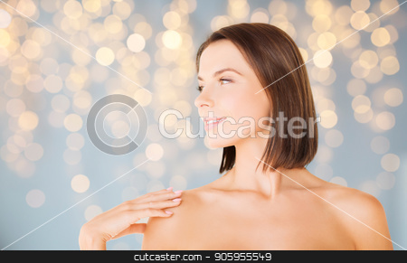beautiful bare woman over green natural background stock photo, wellness and beauty concept - portrait of beautiful bare woman over holidays lights background by Syda Productions