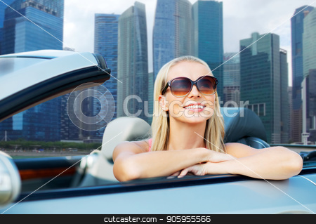 woman in convertible car over singapore city stock photo, travel, road trip and people concept - happy young woman in sunglasses in convertible car over singapore city skyscrapers background by Syda Productions