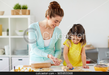 happy mother and daughter making cookies at home stock photo, family, cooking and people concept - happy mother and little daughter with molds making cookies from dough at home kitchen by Syda Productions