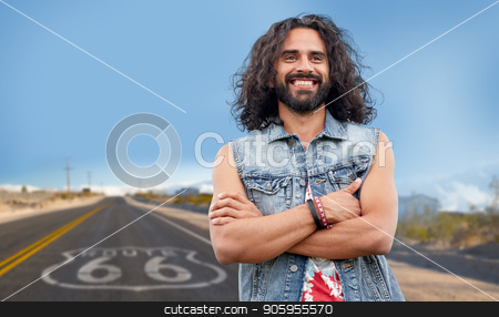 smiling hippie man in denim vest over us route 66 stock photo, subculture, youth culture and people concept - smiling young hippie man in denim vest over us route 66 background by Syda Productions