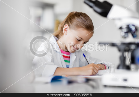 girl studying chemistry at school laboratory stock photo, education, science and children concept - girl studying chemistry at school laboratory and writing to workbook by Syda Productions