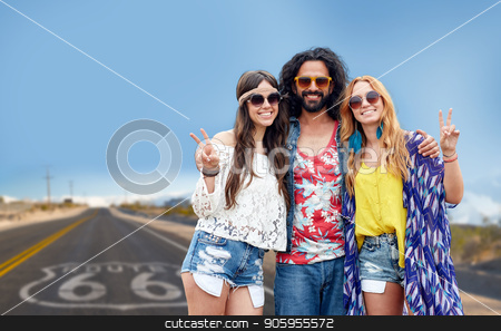 hippie friends showing peace over us route 66 stock photo, nature, summer, youth culture, gesture and people concept - smiling young hippie friends in sunglasses showing peace hand sign over us route 66 background by Syda Productions