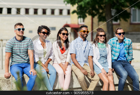 group of happy friends in sunglasses in city stock photo, people, friendship and international concept - group of happy smiling friends in sunglasses in city by Syda Productions