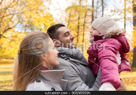 happy family at autumn park stock photo, family, season and people concept - happy mother, father and little daughter at autumn park by Syda Productions