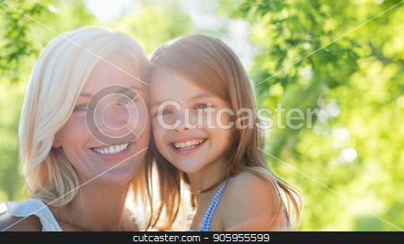 happy mother and daughter over natural background stock photo, family, motherhood and people concept- happy mother and daughter over green natural background by Syda Productions