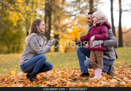 happy family with maple leaves at autumn park stock photo, family, season and people concept - happy father and little daughter giving maple leaves to mother at autumn park by Syda Productions