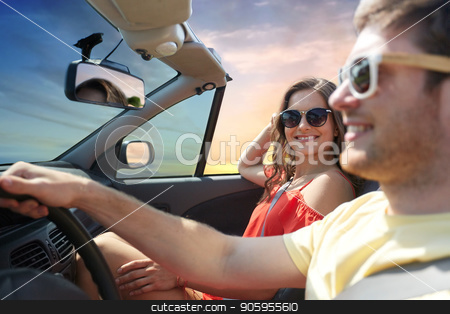 happy couple driving in convertible car stock photo, leisure, road trip, travel, summer holidays and people concept - happy couple driving in convertible car over sky background by Syda Productions