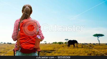 woman with backpack over african savannah stock photo, adventure, travel, tourism, hike and people concept - young woman with backpack over animals in african savannah background by Syda Productions
