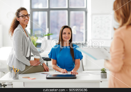 businesswomen at presentation in office stock photo, business and people concept - businesswomen listening to colleague at office presentation by Syda Productions