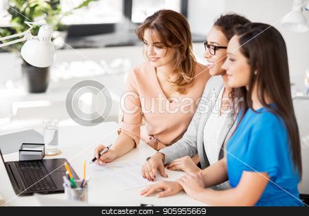 businesswomen with laptop working at office stock photo, business, teamwork and people concept - female team or businesswomen with laptop computer working at office by Syda Productions