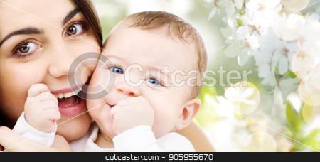 mother with baby over cherry blossom background stock photo, family and motherhood concept - happy smiling young mother with little baby over cherry blossom background by Syda Productions