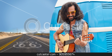 hippie man playing guitar at minivan on route 66 stock photo, road trip, travel and music concept - hippie man playing guitar and singing at minivan car over us route 66 background by Syda Productions