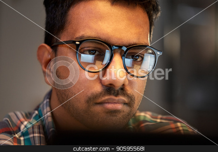 close up of creative man working at night office stock photo, education, deadline and people concept - close up of creative man in glasses working at night office and thinking by Syda Productions