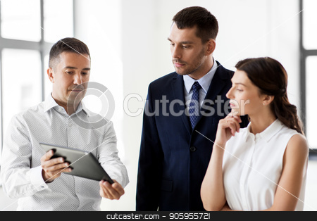 realtor showing tablet pc to customers at office stock photo, real estate business, sale and people concept - happy smiling realtor showing tablet pc computer to customers at new office room by Syda Productions