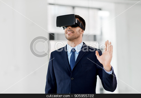 businessman with virtual reality headset at office stock photo, business, technology and augmented reality concept - businessman with vr headset at office by Syda Productions