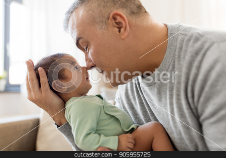 happy father with little baby boy at home stock photo, family, fatherhood and people concept - happy father with little baby boy sitting on sofa at home by Syda Productions