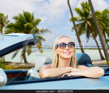 happy young woman in convertible car over beach stock photo, travel, road trip and summer holidays concept - happy young woman in convertible car over exotic beach with palm trees in french polynesia background by Syda Productions