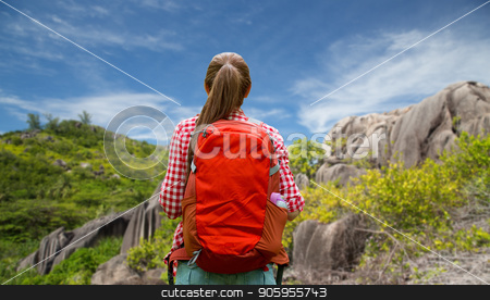 woman with backpack over seychelles island stock photo, adventure, travel, tourism, hike and people concept - young woman with backpack over background of seychelles island by Syda Productions