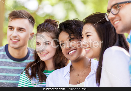group of happy smiling friends outdoors stock photo, people, friendship and international concept - group of happy smiling friends outdoors by Syda Productions