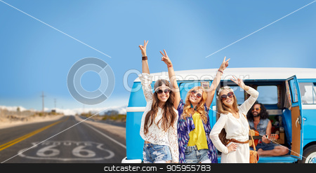 hippie friends over minivan car on us route 66 stock photo, road trip, travel and people concept - happy young hippie friends having fun and dancing at minivan car over us route 66 background by Syda Productions