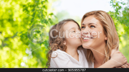 happy daughter hugging and kissing her mother stock photo, family, motherhood and people concept - happy daughter hugging and kissing her mother over green natural background by Syda Productions