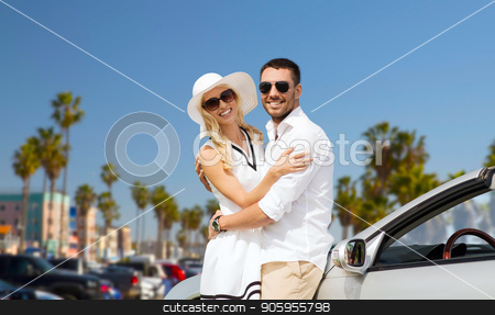 happy couple hugging near convertible car stock photo, travel, love, date and people concept - happy couple hugging near convertible car over venice beach background in california by Syda Productions