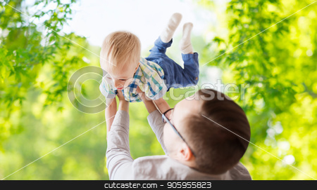 father with son playing and having fun in summer stock photo, family, childhood, fatherhood and people concept - happy father and little son playing and having fun over green natural background by Syda Productions