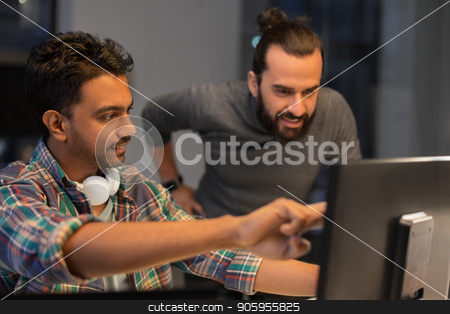 creative team with computer working late at office stock photo, deadline, technology and people concept - creative team coworkers with computers working together late at night office by Syda Productions