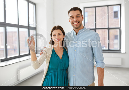 happy couple with keys of new home stock photo, mortgage, people and real estate concept - happy couple with keys at empty room of new home by Syda Productions