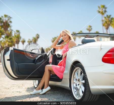 woman posing in convertible car over venice beach stock photo, travel, road trip and people concept - happy young woman posing in convertible car over venice beach background in california by Syda Productions