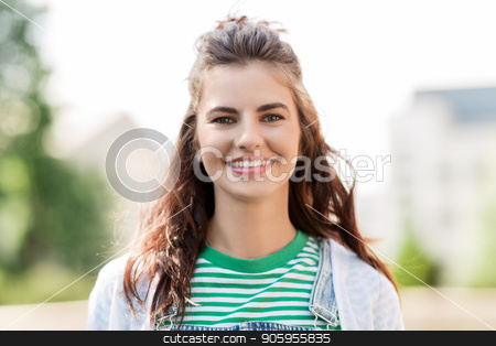 portrait of happy young woman outdoors stock photo, people concept - portrait of happy smiling young woman outdoors by Syda Productions