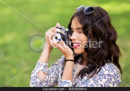 close up of woman with camera shooting outdoors stock photo, photography and people concept - close up of young woman with vintage camera taking picture outdoors by Syda Productions