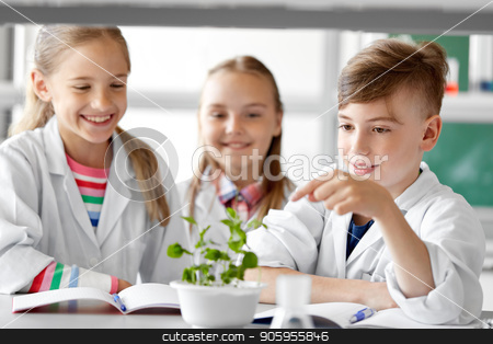 kids or students with plant at biology class stock photo, education, science and school concept - kids or students with plant at biology class by Syda Productions