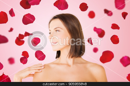 beautiful bare woman over rose petals background stock photo, wellness and beauty concept - portrait of beautiful bare woman over red rose petals on pink background by Syda Productions