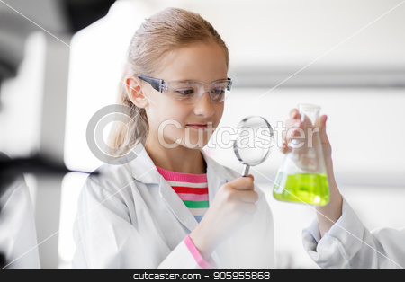 girl studying test tube at school laboratory stock photo, education, science and children concept - girl with magnifier studying test tube with chemical at school laboratory by Syda Productions