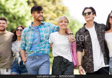 happy friends with picnic blanket at summer park stock photo, friendship and leisure concept - group of happy friends with picnic blanket at summer park by Syda Productions