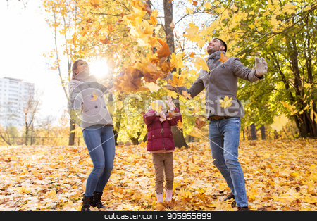 happy family playing with autumn leaves at park stock photo, family, season and people concept - happy mother, father and little daughter playing with autumn leaves at park by Syda Productions